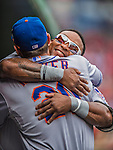 28 July 2013: New York Mets outfielder Marlon Byrd gives Anthony Recker a hug in the dugout prior to the start of a game against the Washington Nationals at Nationals Park in Washington, DC. The Nationals defeated the Mets 14-1. Mandatory Credit: Ed Wolfstein Photo *** RAW (NEF) Image File Available ***