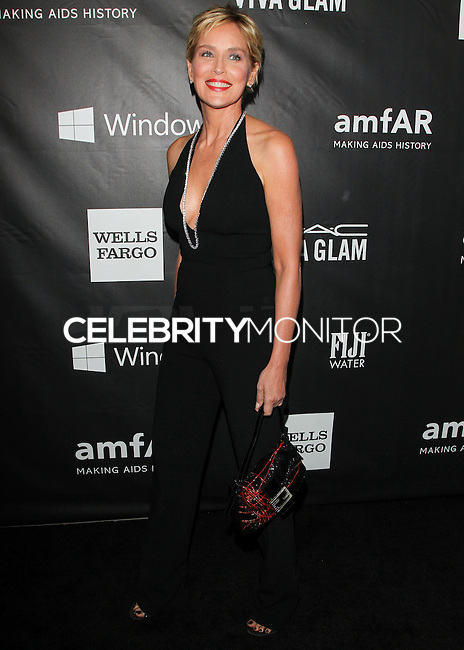 HOLLYWOOD, LOS ANGELES, CA, USA - OCTOBER 29: Sharon Stone arrives at the 2014 amfAR LA Inspiration Gala at Milk Studios on October 29, 2014 in Hollywood, Los Angeles, California, United States. (Photo by Celebrity Monitor)