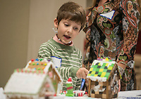 STAFF PHOTO ANTHONY REYES &bull; @NWATONYR<br /> Ethan Ham, 7, of Bentonville, talks about some of the features of gingerbread houses on display Friday, Dec. 5, 2014 at the Arkansas Virtual Academy's winter party at the Jones Center in Springdale. The event featured a number of games, crafts and a gingerbread house competition with prizes going to the winners in different age categories.