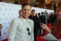 "ST. PAUL, MN JULY 16:2016 American Idol Trent Norton talks to reporters on the red carpet at the Starkey Hearing Foundation ""So The World May Hear Awards Gala"" on July 16, 2017 in St. Paul, Minnesota. Credit: Tony Nelson/Mediapunch"