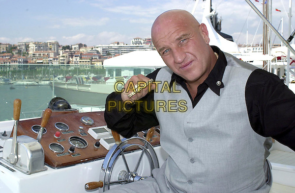 DAVE COURTNEY.Former London gangster who is in Cannes to promote two films in which he stars,.Cannes Film Festival, France, 13th May 2001..half length gold knuckle duster.Ref: PL.www.capitalpictures.com.sales@capitalpictures.com.©Capital Pictures.