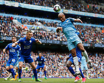 Vincent Kompany of Manchester City climbs to try and connect with a header as Andy King of Leicester City waits to clear during the English Premier League match at the Etihad Stadium, Manchester. Picture date: May 13th 2017. Pic credit should read: Simon Bellis/Sportimage