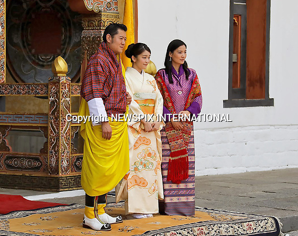 02.06.2017;Thimpu, Bhutan: PRINCESS MAKO OF JAPAN WITH KING WANGCHUCK AND QUEEN JETSUN PEMA OF BHUTAN<br /> at the audience with the King at the Tashichhodzong. <br /> Her Imperial Highness Princess Mako of Japan, the granddaughter of The Emperor of Japan, is on a 9-day official visit to Bhutan.<br /> Princess Mako will soon lose her royal title. Under Japan&rsquo;s controversial law, any female royal family member loses her status on marrying a commoner. This has reignited debate on the male-only succession to the world&rsquo;s oldest hereditary monarchy with the emperor also possibly abdicating soon.<br /> The 25-year-old eldest granddaughter of Emperor Akihito will become engaged to law firm worker Kei Komuro, also 25, whom she met while studying together.<br /> The engagement will only be official after a ceremonial exchange of gifts, with the wedding expected to take place next year.<br /> Mandatory Credit Photo: &copy;Royal Office/NEWSPIX INTERNATIONAL<br /> <br /> IMMEDIATE CONFIRMATION OF USAGE REQUIRED:<br /> Newspix International, 31 Chinnery Hill, Bishop's Stortford, ENGLAND CM23 3PS<br /> Tel:+441279 324672  ; Fax: +441279656877<br /> Mobile:  07775681153<br /> e-mail: info@newspixinternational.co.uk<br /> Please refer to usage terms. All Fees Payable To Newspix International