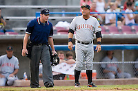 Frederick manager Tommy Thompson has a discussion with home plate umpire Andy Dudones at Ernie Shore Field in Winston-Salem, NC, Wednesday, August 15, 2007.