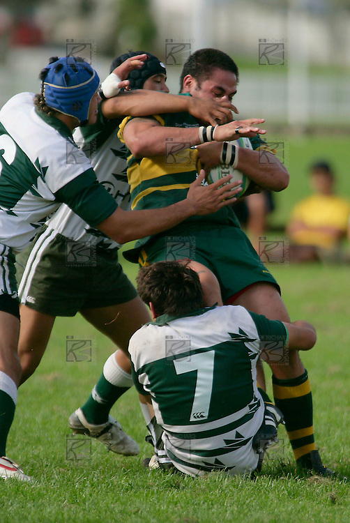 S. Tualalilelei is wrapped up well and truly by Manurewa tacklers. Counties Manukau Premier Club Rugby, Pukekohe v Manurewa  played at the Colin Lawrie field, on the 17th of April 2006. Manurewa won 20 - 18.
