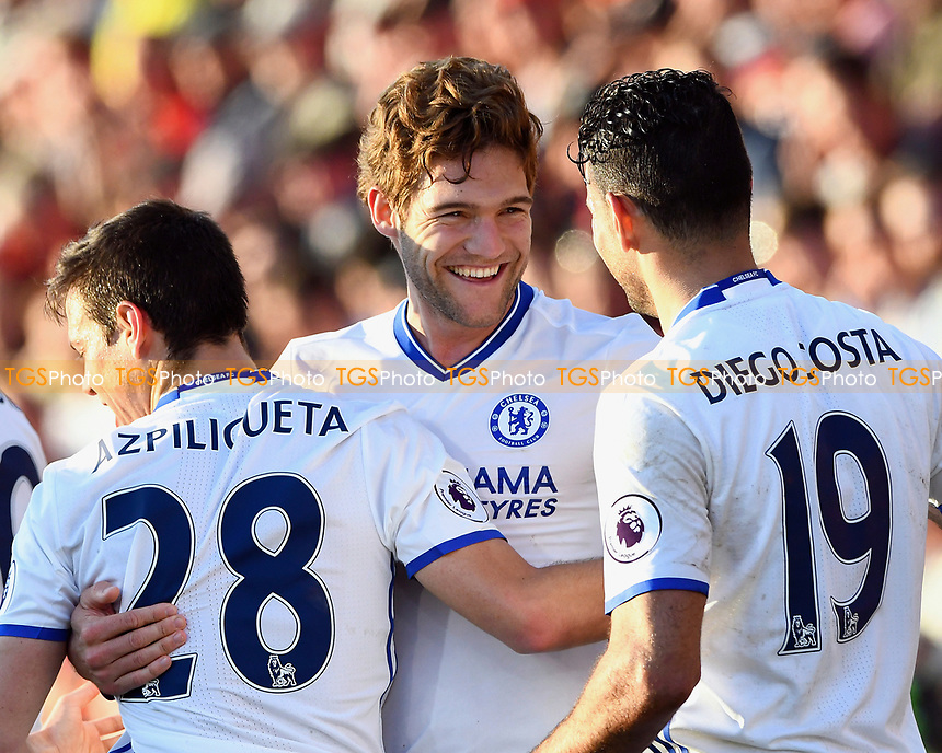 Marcos Alonso of Chelsea middle is congratulated on scoring the third goal by Cesar Azpilicueta and Diego Costa during AFC Bournemouth vs Chelsea, Premier League Football at the Vitality Stadium on 8th April 2017