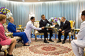 United States President Barack Obama presents a gift to King Bhumibol Adulyadej of Thailand during their meeting at Siriraj Hospital in Bangkok, Thailand, Nov. 18, 2012. President Obama presented a photo album containing photos of the King with U.S. Presidents and First Ladies dating back to President Eisenhower. U.S. Ambassador to Thailand Kristie Kenney with Secretary of State Hillary Rodham Clinton are seated at left. (Official White House Photo by Pete Souza)..This official White House photograph is being made available only for publication by news organizations and/or for personal use printing by the subject(s) of the photograph. The photograph may not be manipulated in any way and may not be used in commercial or political materials, advertisements, emails, products, promotions that in any way suggests approval or endorsement of the President, the First Family, or the White House..Mandatory Credit: Pete Souza - White House via CNP