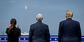 In this photo released by the National Aeronautics and Space Administration (NASA), President Donald Trump, right, Vice President Mike Pence, and Second Lady Karen Pence watch the launch of a SpaceX Falcon 9 rocket carrying the company's Crew Dragon spacecraft on NASA's SpaceX Demo-2 mission with NASA astronauts Robert Behnken and Douglas Hurley onboard, Saturday, May 30, 2020, from the balcony of  Operations Support Building II at NASA's Kennedy Space Center in Florida. NASA's SpaceX Demo-2 mission is the first launch with astronauts of the SpaceX Crew Dragon spacecraft and Falcon 9 rocket to the International Space Station as part of the agency's Commercial Crew Program. The test flight serves as an end-to-end demonstration of SpaceX's crew transportation system. Behnken and Hurley launched at 3:22 p.m. EDT on Saturday, May 30, from Launch Complex 39A at the Kennedy Space Center. A new era of human spaceflight is set to begin as American astronauts once again launch on an American rocket from American soil to low-Earth orbit for the first time since the conclusion of the Space Shuttle Program in 2011. <br /> Mandatory Credit: Bill Ingalls / NASA via CNP