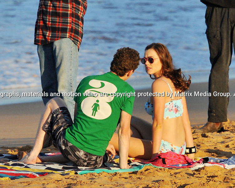 2nd July, 2014 SYDNEY AUSTRALIA<br /> EXCLUSIVE <br /> Pictured, Demi Harman in a bikini, Alec Snow &amp; Andrew Morley watches during a shoot at the location for Summer Bay on Sydneys Palm Beach, NSW<br /> <br /> *No internet without clearance*.MUST CALL PRIOR TO USE +61 2 9211-1088. Matrix Media Group.Note: All editorial images subject to the following: For editorial use only. Additional clearance required for commercial, wireless, internet or promotional use.Images may not be altered or modified. Matrix Media Group makes no representations or warranties regarding names, trademarks or logos appearing in the images.