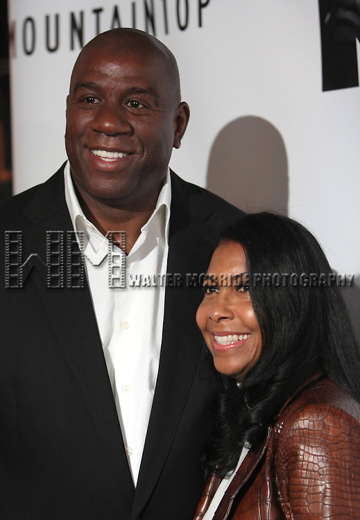 Magic Johnson & wife.attending the Opening Night Performance of 'The Mountaintop' at the Bernhard B.  Jacobs Theatre in New York City.
