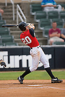 Jon Gilmore #20 of the Kannapolis Intimidators follows through on his swing versus the Rome Braves at Fieldcrest Cannon Stadium July 28, 2009 in Kannapolis, North Carolina. (Photo by Brian Westerholt / Four Seam Images)