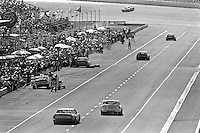 BROOKLYN, MI - AUGUST 11: An overview of activity on pit lane during the Champion Spark Plug 400 NASCAR Winston Cup race at the Michigan International Speedway near Brooklyn, Michigan, on August 11, 1985.