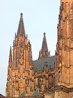 Detail of the Gothic towers of St Vitus cathedral, a Roman catholic cathedral founded 1344, within Prague Castle, Prague, Czech Republic. The cathedral has a triple nave, a short transept and a five-bayed choir and decagon apse with ambulatory and radiating chapels. The cathedral's full name is the St Vitus, St Wenceslas and St Adalbert cathedral and is the largest church in the Czech Republic. The historic centre of Prague was declared a UNESCO World Heritage Site in 1992. Picture by Manuel Cohen