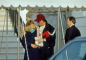 United States President Bill Clinton hugs first lady Hillary Rodham Clinton outside the White House in Washington, DC as he completed his morning jog and she departed for a day trip to Philadelphia and Harrisburg, Pennsylvania on February 11, 1993.  Mrs. Clinton plans to visit a hospital in Philadelphia and attend a health care conference in Harrisburg.<br /> Credit: Dennis Brack / Pool via CNP