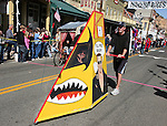 The Urinator, driven by Joy Hall, in the Virginia City Outhouse Races parade.  The outhouse is pushed by Joe Bell, left and Kristopher Hall.  Photo by Tom Smedes.