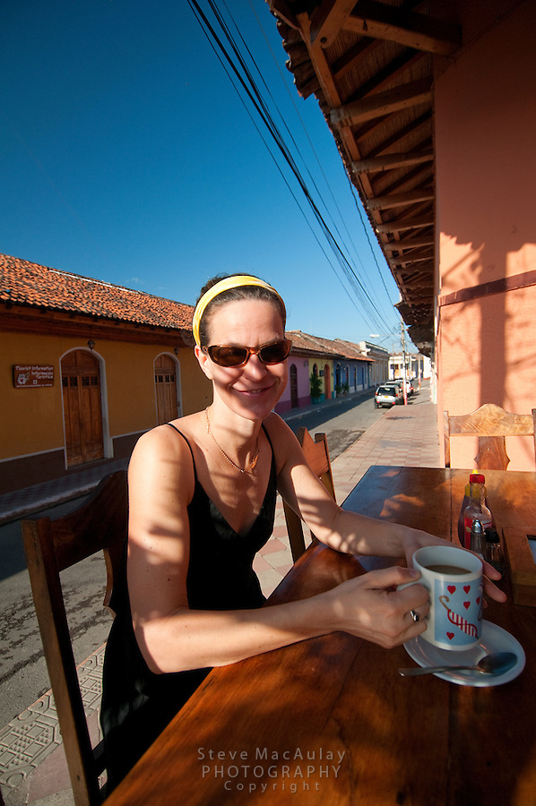 Young woman enjoys her morning coffee at the Granda institution, Kathy's Waffle House, Nicaragua