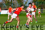 Brian O Beaglaoich An Ghaeltacht  goes past John McGuinness Mallow during the Munster Intermediate Championship semi final in Mallow on Sunday