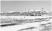 D&amp;RGW K-37 approaching Poncha Junction eastbound with limestone from Monarch.  Snow &amp; mountains in distance.<br /> D&amp;RGW  Poncha Junction, CO  Taken by Richardson, Robert W. - 1/7/1949
