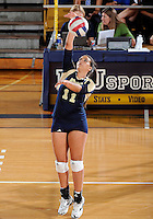 Florida International University women's volleyball player Paola Ortiz (11) plays against Western Kentucky University.  Western Kentucky won the match 3-0 on September 30, 2011 at Miami, Florida. .