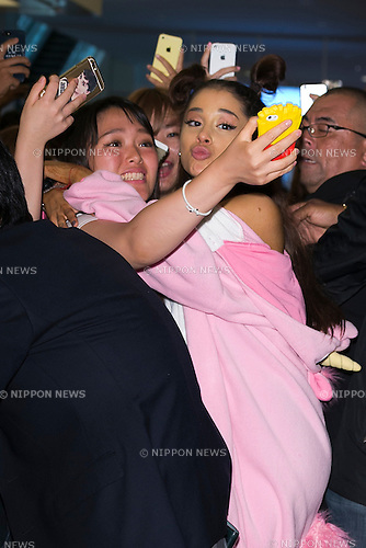 American singer and actress Ariana Grande greets fans upon her arrival at Tokyo International Airport on August 13, 2015, Tokyo, Japan. Ariana came from Los Angeles to Japan to perform at the annual music festival ''Summer Sonic 2015'' held in Tokyo and Osaka. (Photo by Rodrigo Reyes Marin/AFLO)