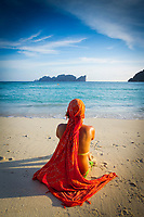 Young woman relaxing, Long beach, Phi Phi Don island, Krabi Province, Andaman Sea, Thailand