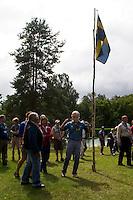 King Carl Gustav and flag of Sweden. Photo: Mikko Roininen / Scouterna