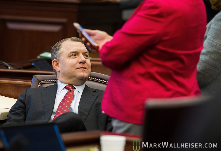 Sen. Rob Bradley, R-Fleming Island listens to colleague during a Senate recess at the Florida Capitol in Tallahassee, Florida.