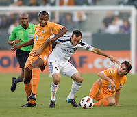 LA Galaxy midfielder Landon Donovan (10) battles Puerto Islanders Noah Delgado (5) and Christopher Nurse (8). The Puerto Rico Islanders defeated the LA Galaxy 4-1 during CONCACAF Champions League group play at Home Depot Center stadium in Carson, California on Tuesday July 27, 2010.