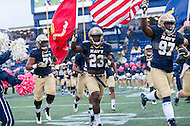 Annapolis, MD - OCT 8, 2016: Navy Midshipmen running back Kendrick Mouton (23) runs onto the field with the flag before the game between Houston and Navy at Navy-Marine Corps Memorial Stadium Annapolis, MD. The Midshipmen upset #6 Houston 46-40. (Photo by Phil Peters/Media Images International)