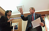 United States President George W. Bush meets with National Security Advisor Condoleezza Rice inside his office at Camp David, the Presidential retreat near Thurmont, Maryland on Sunday morning, September 16, 2001.<br /> Mandatory Credit: Eric Draper / White House via CNP