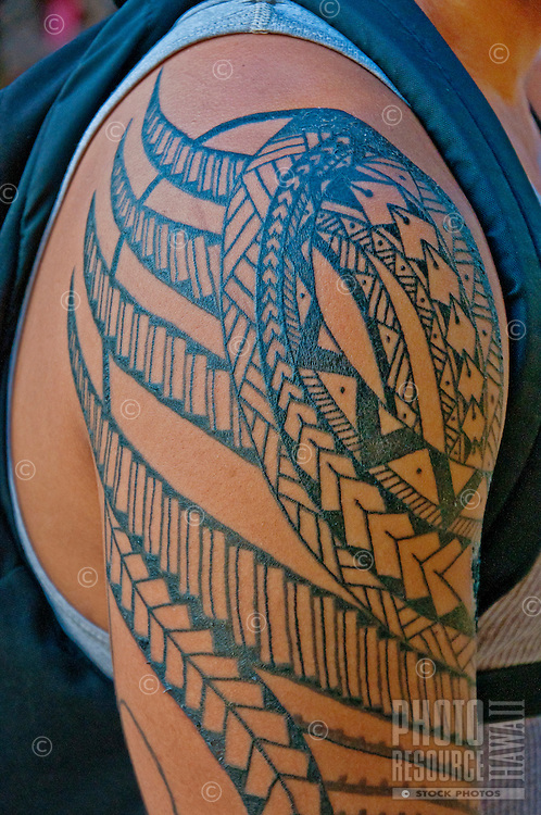 A local man sports an intricate swirled tattoo on his arm in Waikiki, O'ahu.