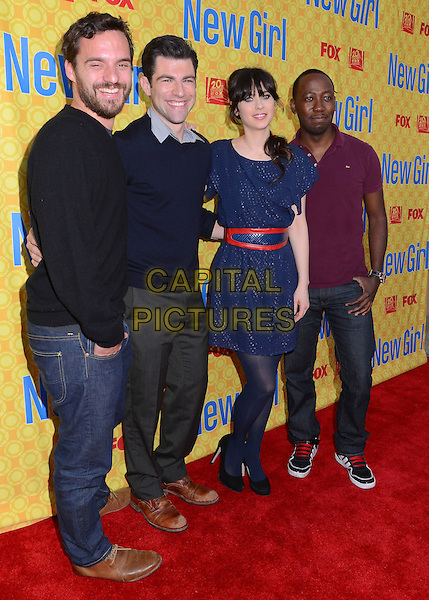 Jake Johnson, Max Greenfield, Zooey Deschanel & Lamorne Morris.'New Girl' cast at screening and Q&A at Leonard H. Goldenson Theatre, North Hollywood, California, USA..7th May 2012.full length black hand in pocket beard facial hair sweater jumper top  blue dress jeans denim purple top.CAP/ADM/BT.©Birdie Thompson/AdMedia/Capital Pictures.