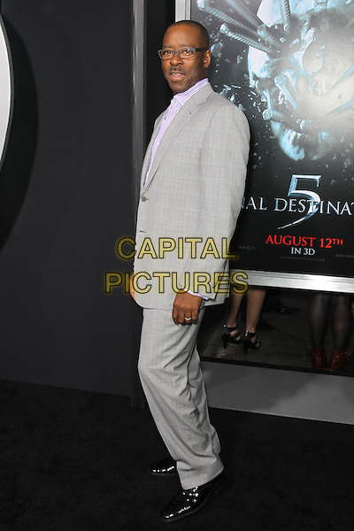 """COURTNEY B. VANCE.Los Angeles special screening of New Line Cinema's """"Final Destination 5"""" at Grauman's Chinese Theatre. Hollywood, CA USA. .August 10th, 2011.full length suit glasses side grey gray  .CAP/CEL.©CelPh/Capital Pictures."""