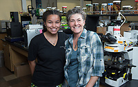 Shana Goffredi, associate professor of Biology and Chelsea Blankenchip '17, a Biochemistry major, wrote her senior comprehensive paper (comp) on viruses and bacteria and her honors thesis on her research with beetle gut bacteria. Photo taken May 12, 2017 in the Bioscience building.<br />