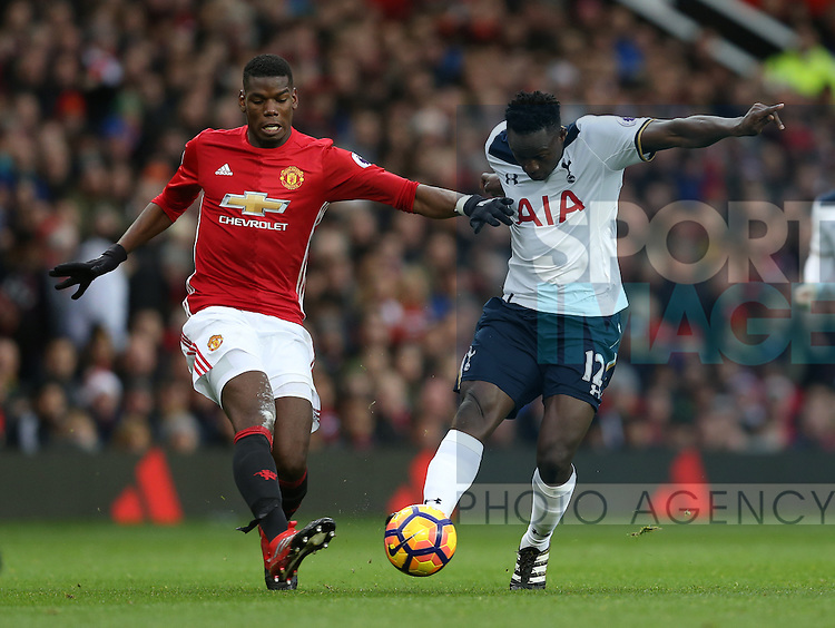 Paul Pogba of Manchester United and Victor Wanyama of Tottenham during the English Premier League match at Old Trafford Stadium, Manchester. Picture date: December 11th, 2016. Pic Simon Bellis/Sportimage