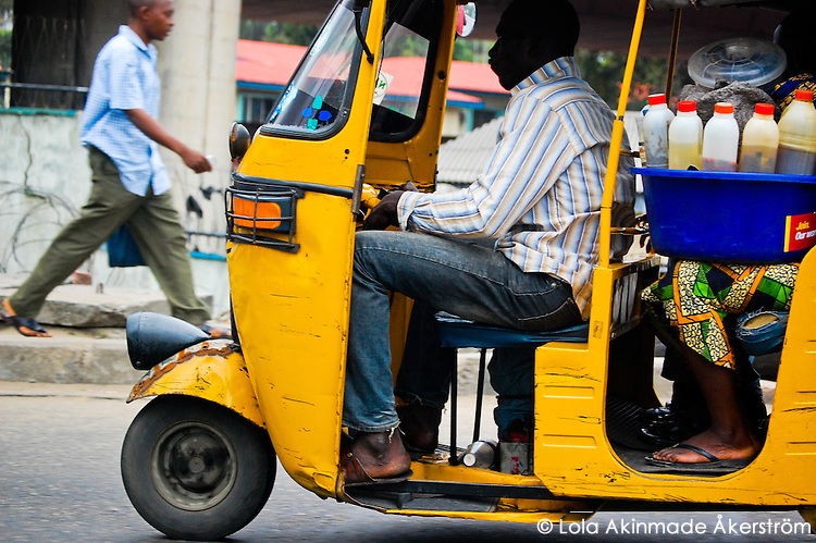 Nigeria - Taking palm oil and vegetable oil to the market to sell.