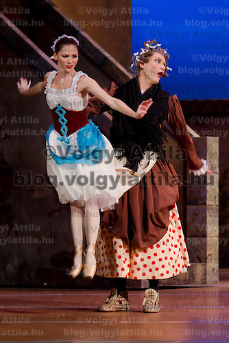 Dancers Adrienn Pap (left) as Lise and Komarov Alekszandr (right) as Simone in the dance piece La Fille Mal Gardee or The Wayward Daughter Choreographed by Sir Frederick Ashton presented by the Hungarian National Ballet Company in Hungary State Opera House,  Budapest, Hungary, Tuesday, 23. November 2010. ATTILA VOLGYI