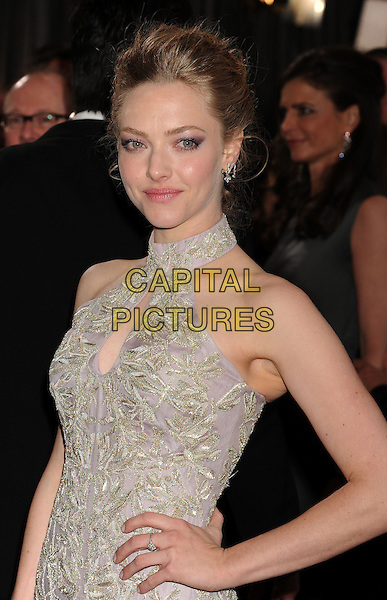 Amanda Seyfried (wearing Alexander McQueen).85th Annual Academy Awards held at the Dolby Theatre at Hollywood & Highland Center, Hollywood, California, USA..February 24th, 2013.oscars half length dress hand on hip embellished high collar keyhole bust cut out lilac purple sheer gold embroidered print sleeveless .CAP/ROT/TM.©Tony Michaels/Roth Stock/Capital Pictures