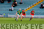 Dougie Fitzell of Kilmoyley keep an eye on the sliotar as Crotta duo Darragh O'Donoghue and Eamon Shanahan close dowm on him, during their encounter in the Qtr final on Senior Hurling Championship.