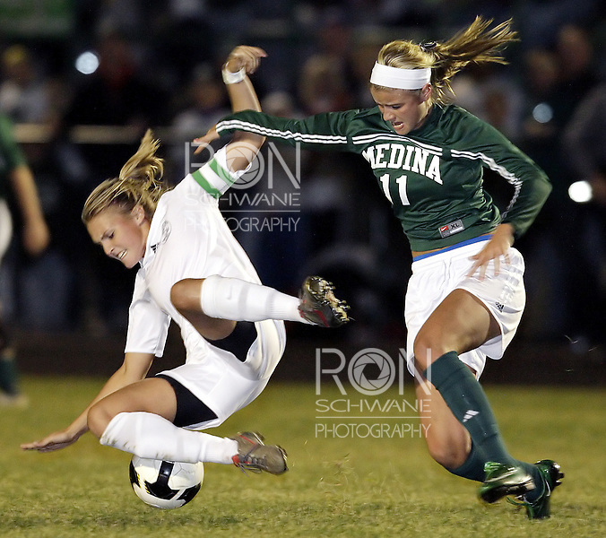 Medina's Rebecca Candler fights for the ball against Strongsville's Robin Waskowski during the first half. (Photo by Ron Schwane)