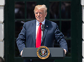 United States President Donald J. Trump makes remarks as he hosts Martin Truex Jr., the NASCAR Cup Series champion, and his team, on the South Lawn of the White House in Washington, DC on Monday, May 21, 2018.  Truex competes full-time in the Monster Energy NASCAR Cup Series for Furniture Row Racing.<br /> Credit: Ron Sachs / CNP