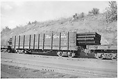 3/4 view of D&amp;RGW high-side gondola #1139 loaded with pipe.  An idler flatcar is coupled to each end.<br /> D&amp;RGW    ca. 1947