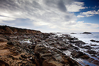 Clouds,blue sky and <br /> the craggy coast at Bean Hollow State Beach, California.