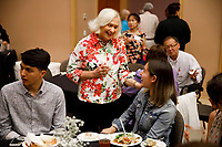 USA International Harp Competition Founder and Artistic Director Susann McDonald, center, speaks with a contestant during the opening reception and dinner of the 11th USA International Harp Competition at Indiana University in Bloomington, Indiana on Wednesday, July 3, 2019. (Photo by James Brosher)