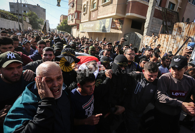 Mourners carry the body of Palestinian Rayid alsrsawy, 30, who was died of his wounds on 13 November 2019 during the recent escalation in Gaza, during his funeral in Gaza Strip, on November 29, 2019. Photo by Ashraf Amra