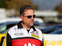 Nov 7, 2013; Pomona, CA, USA; Crew chief for NHRA top fuel dragster driver Doug Kalitta during qualifying for the Auto Club Finals at Auto Club Raceway at Pomona. Mandatory Credit: Mark J. Rebilas-