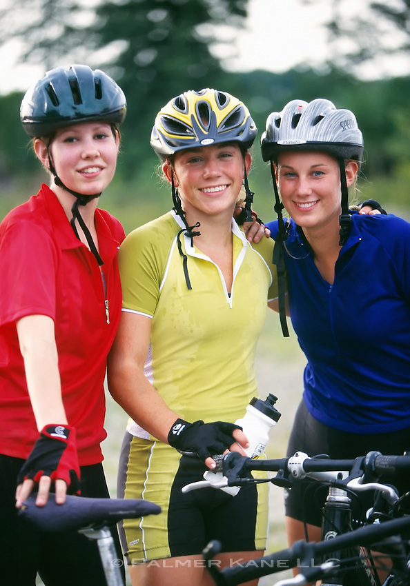 Caucasian Teenage Girls Pose for Portrait with Mountain Bikes