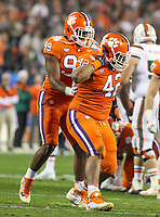 Charlotte, NC - December 2, 2017: Clemson Tigers defensive lineman Christian Wilkins (42) celebrates after making a sack during the ACC championship game between Miami and Clemson at Bank of America Stadium in Charlotte, NC.  (Photo by Elliott Brown/Media Images International) Clemson defeated Miami 38-3 for their third consecutive championship title.