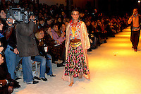 Rome 31 January 2005.A model wears a creation of Italian designer Romeo Gigli, during a gypsy-inspired collection, at Rome's fashion week,