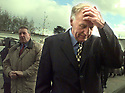 Irish Foreign Minster David Andrews (right) walks away from the media outside Castle Buildings, Stormont, Thursday, April 9, 1998, as the Northern Ireland Peace Talks began to face this  todays important deadline, midnight GMT. (AP Photo/Paul McErlane)